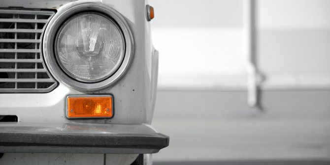 Retro car front close up. Round headlight